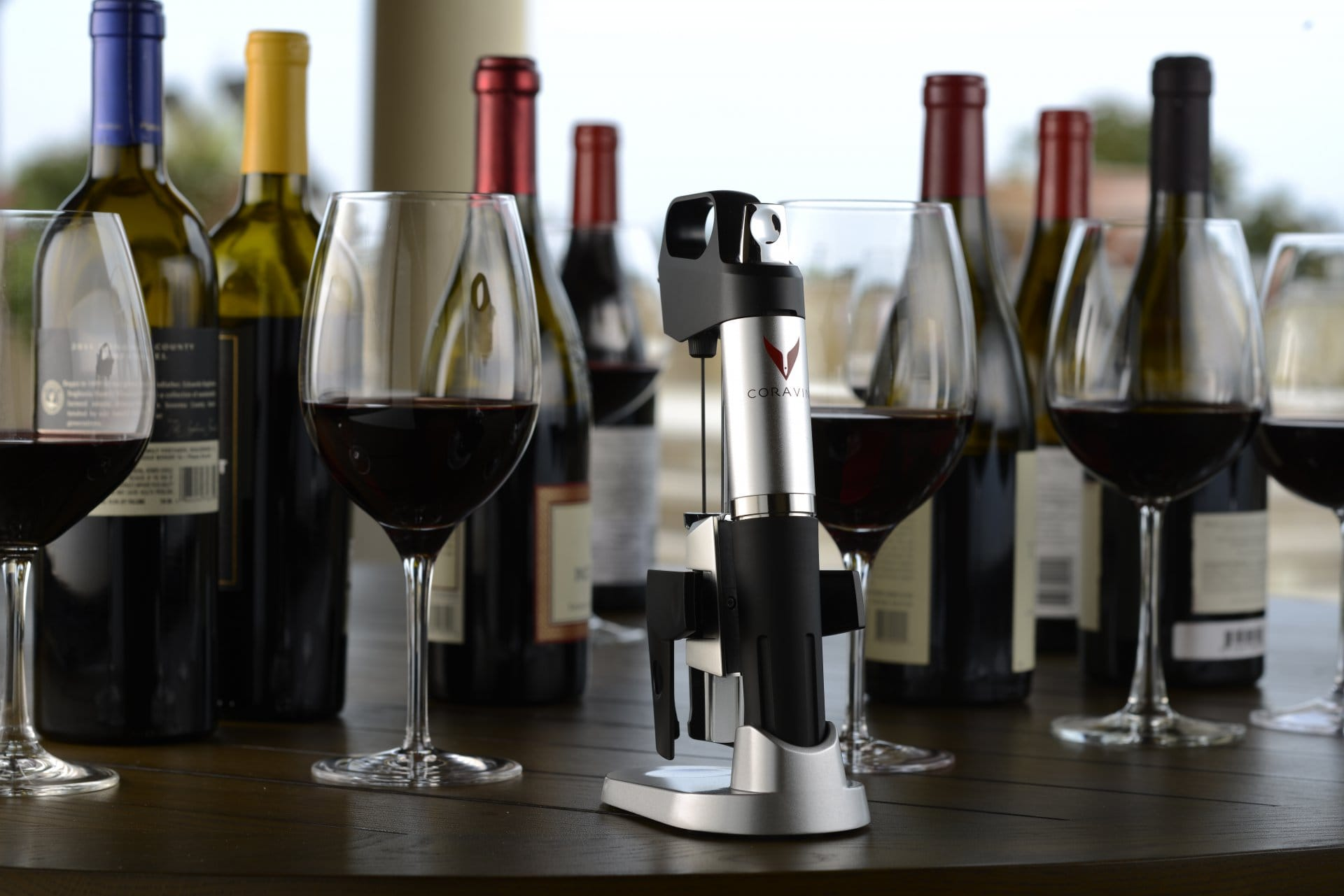 Coravin amongst wine glasses